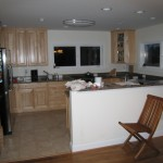 Newly remodeled kitchen with tile flooring, new cabinets, countertops and appliances